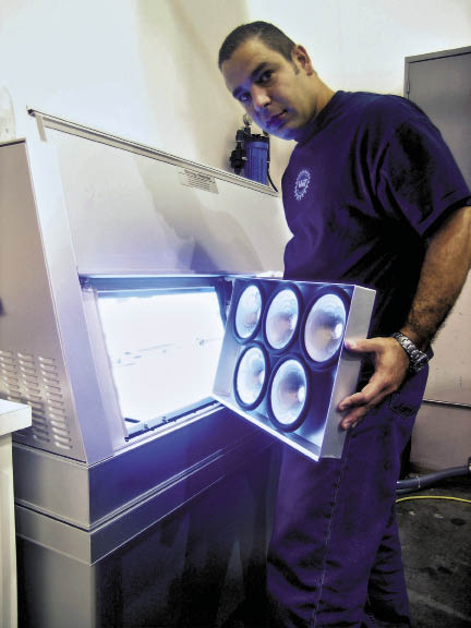 UV Testing of marine speaker cone assemblies in JL Audio's engineering department.