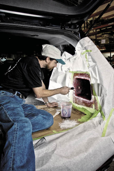 Fiberglass Stealthboxes being wrapped in carpet.