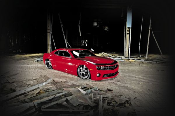 "They were discussing a SEMA build and after realizing how unusual it would be to cut up a brand new Camaro, Julia had an idea. ""Hell, use my Camaro, I haven't even driven it yet"" she said. And so the project got underway."